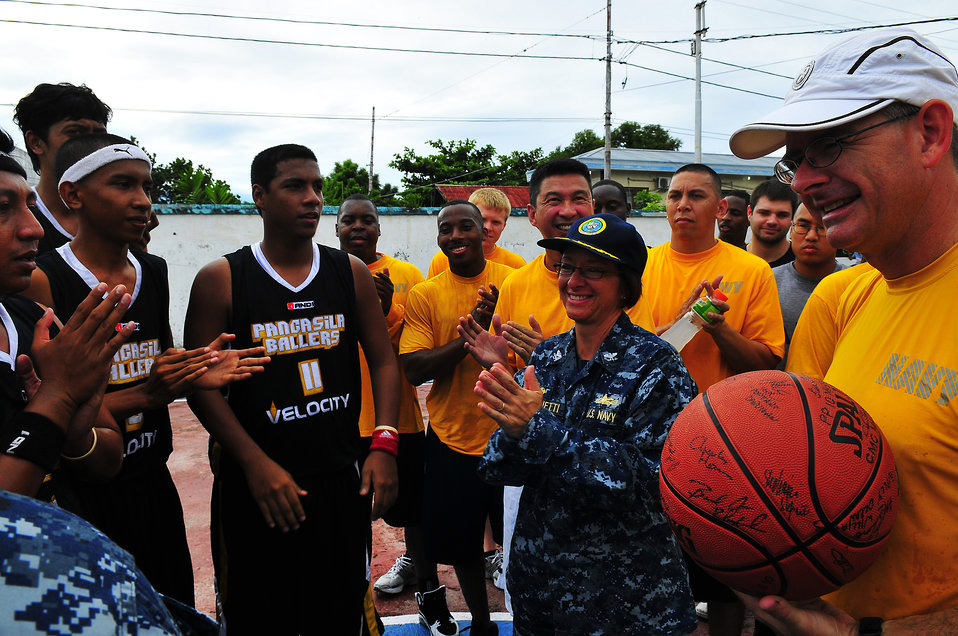 PP2010 Commander Capt. Franchetti Hands off the Game Ball to Indonesian Sailors
