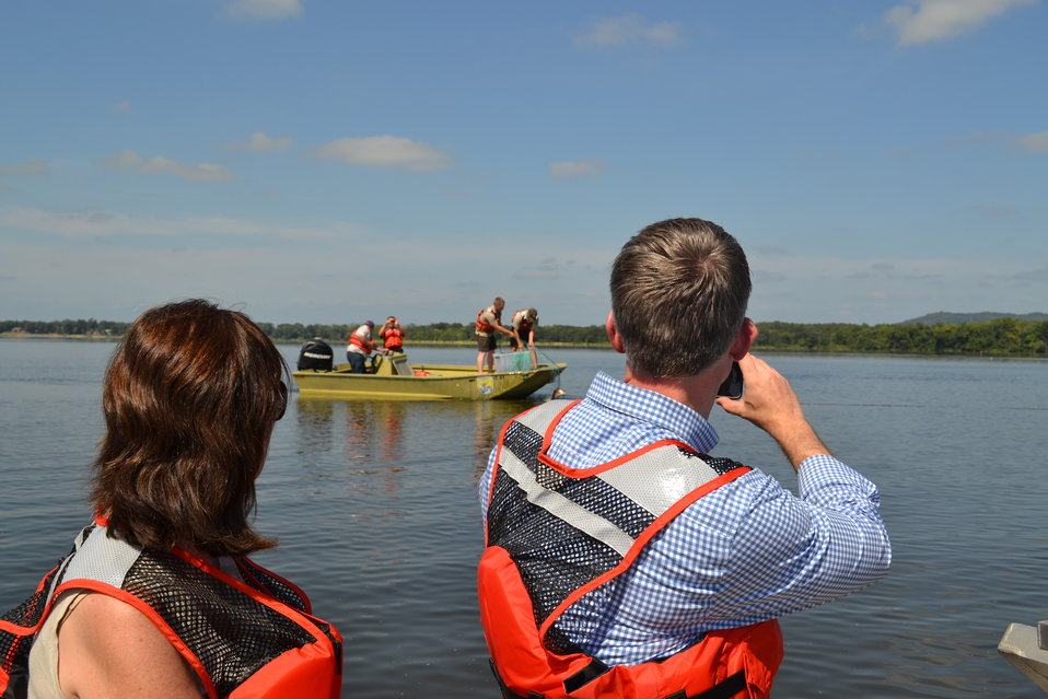 FWS staff retrieve gill net