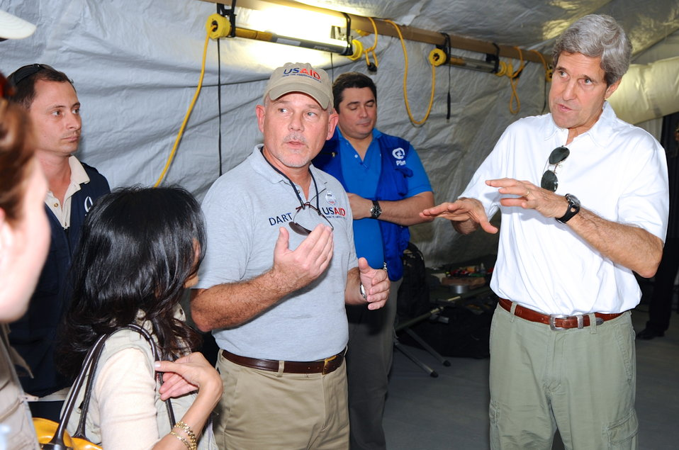Secretary Kerry Receives a Typhoon Haiyan Recovery Briefing During Visit to Forward Operating Base in Tacloban City