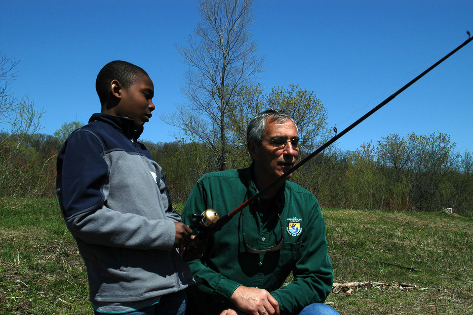 Regional Director Tom Melius Chats with Student About Fishing Experiences
