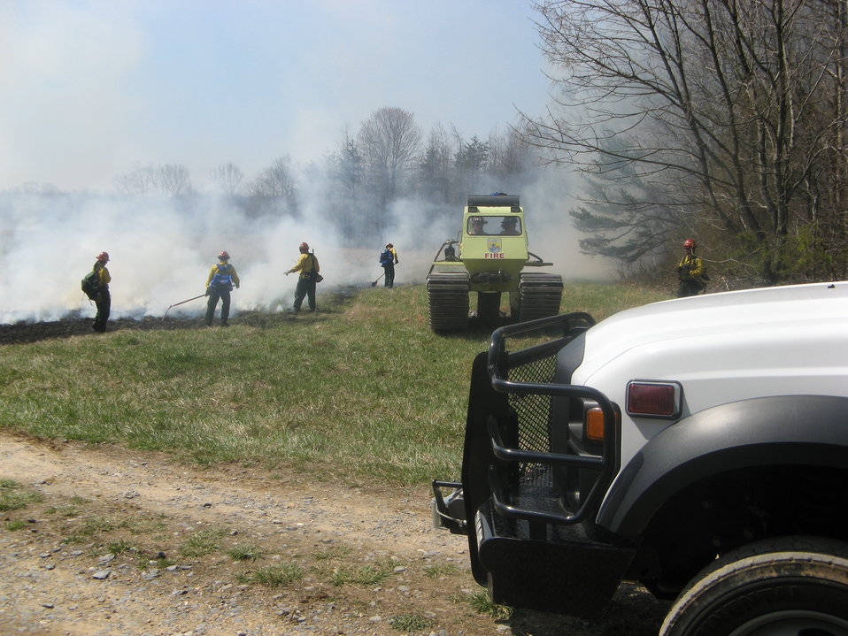 Firefighters and equipment at controlled burn