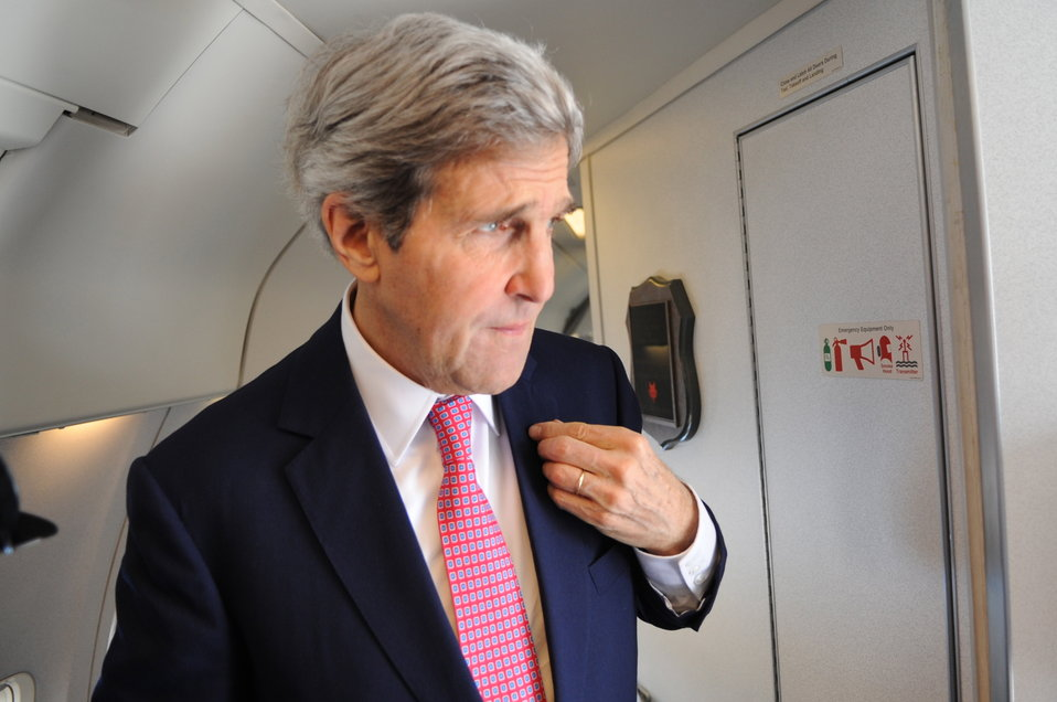 Secretary Kerry Adjusts American Flag Pin Before Arriving in Vietnam
