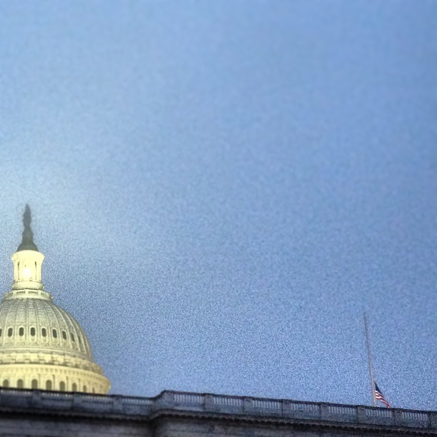 Capitol Dome on foggy evening in #dc, flag flies at half-staff over the Senate.