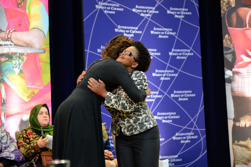 First Lady Michelle Obama Embraces 2014 IWOC Awardee Beatrice Mtetwa of Zimbabwe
