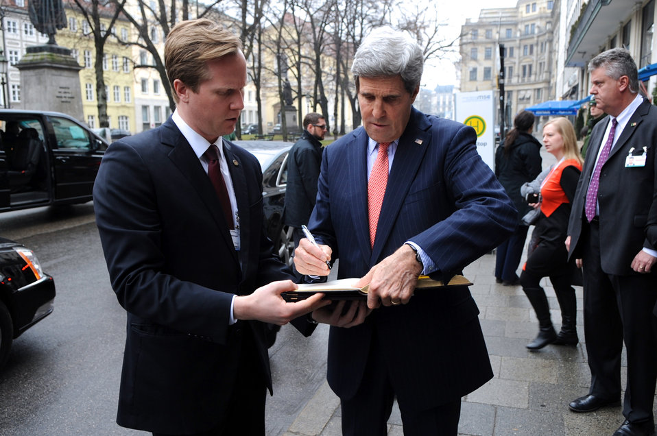 Secretary Kerry Signs Guest Book For Host Hotel of Munich Security Conference