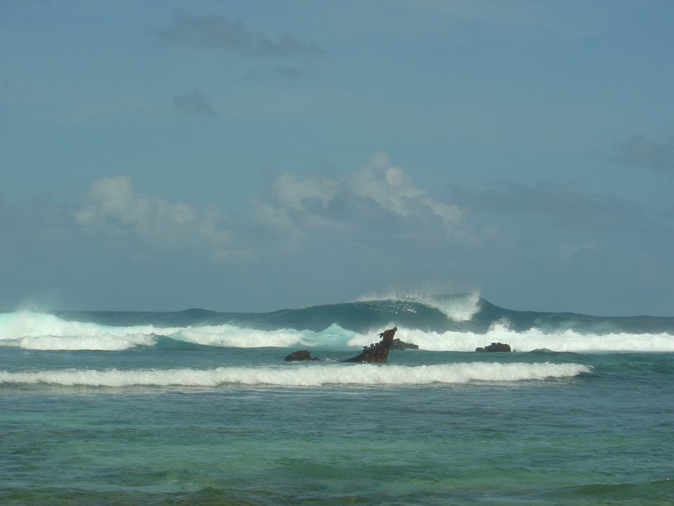 Annuu shipwreck seen in the surfline as large waves pummel the reef.
