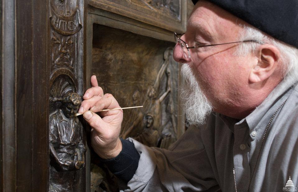 Conservators clean the Amateis Bronze Doors