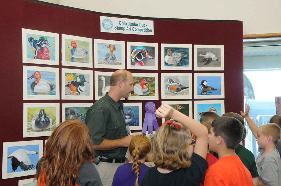 Ohio Division of Wildlife lead school group through artwork exhibit hall, which included a display of the 2013 Ohio Junior Duck Stamp artwork