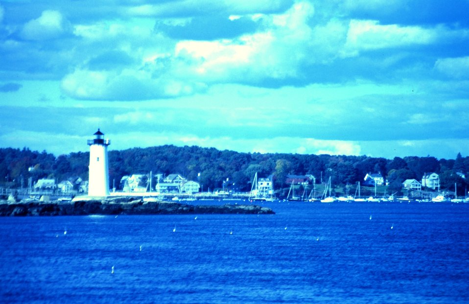 A view of the lighthouse guarding the harbor entrance.