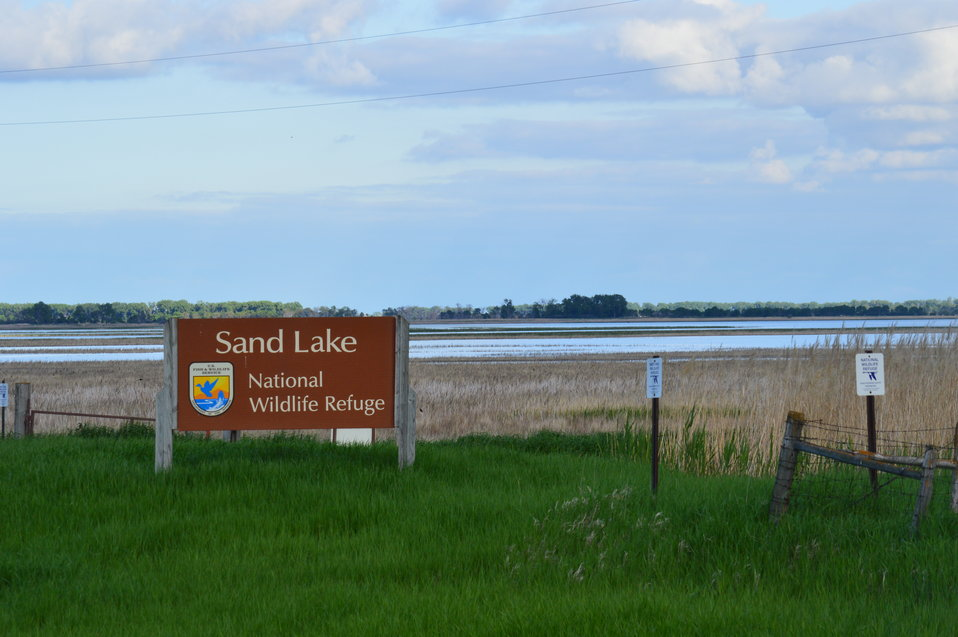 Sand Lake NWR sign and scenery