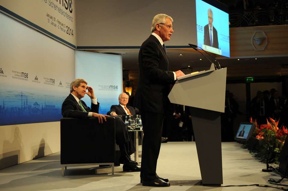 Secretary Kerry Listens as Secretary Hagel Addresses Munich Security Conference