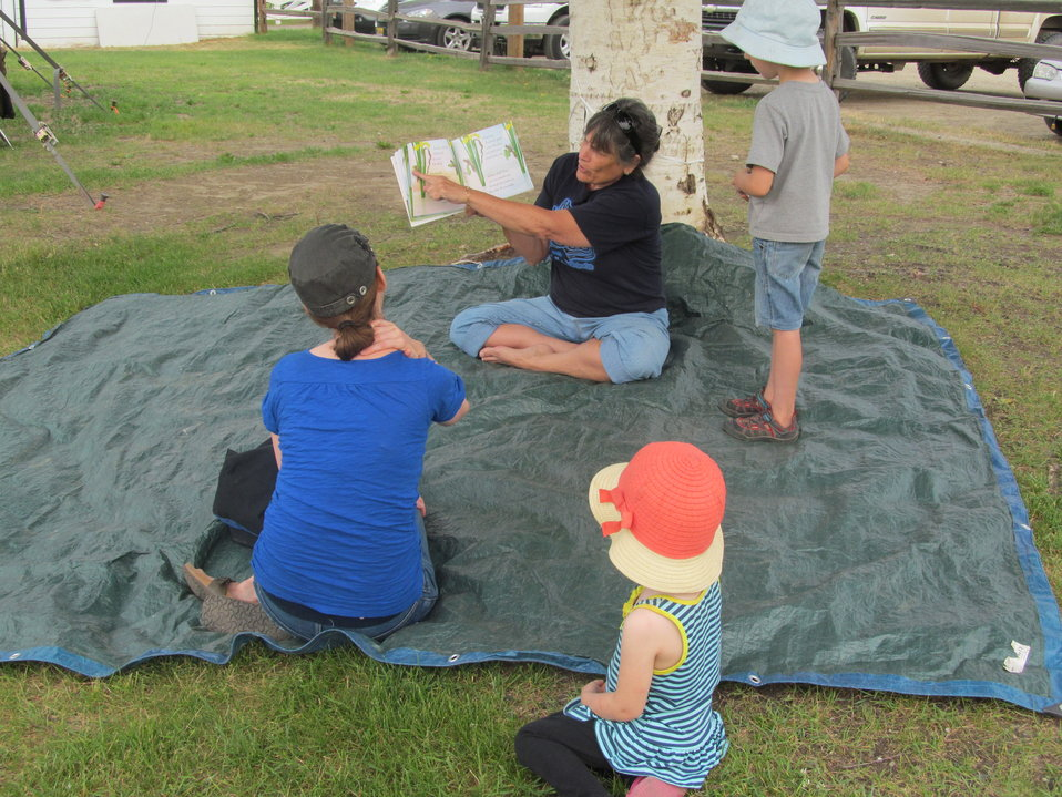 Story time! Friends of Alaska NWR volunteer Henrietta reads the book, Are you a Dragonfly?