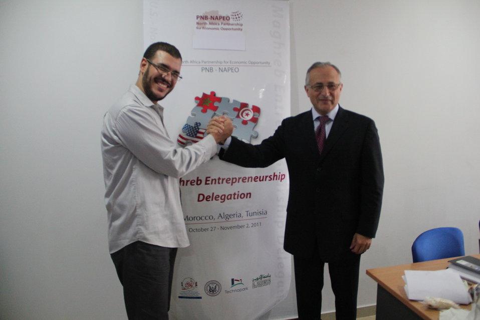 Algerian Tech Town Winner Benali Shakes Hands With Tech Town Wayne State Represetnative Chebbani