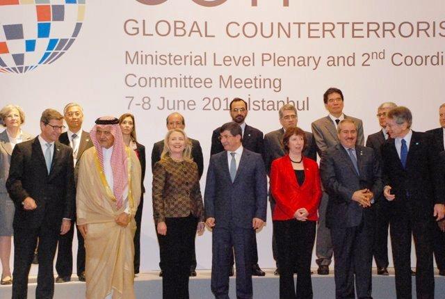 Secretary Clinton Poses for the Family Photo