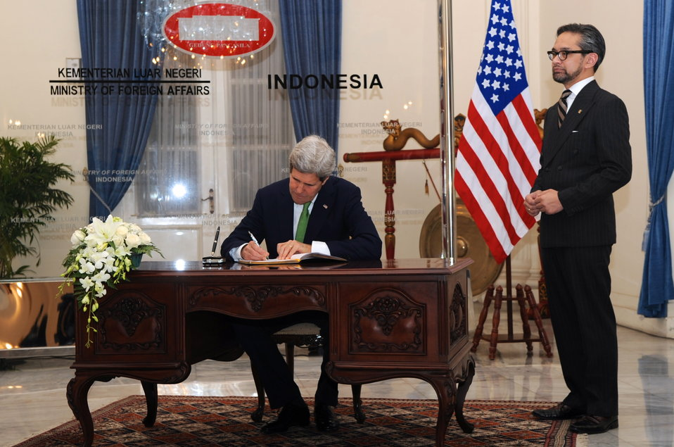 Secretary Kerry Signs Guest Book at Indonesian Ministry of Foreign Affairs