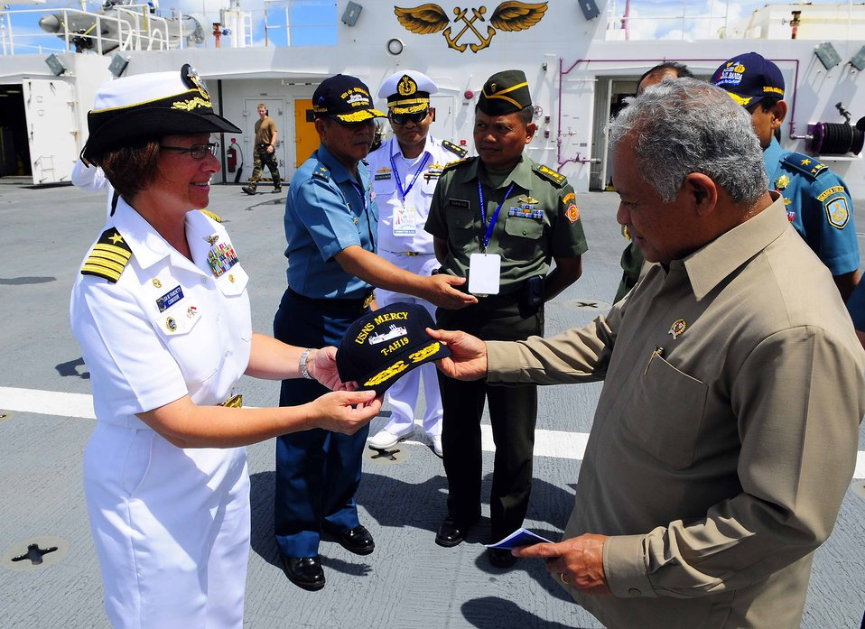PP 2010 Commander Capt. Franchetti Gives a USNS Mercy Ball Cap to Indonesian Defense Minister Dr. Purnomo Yusgiantoro