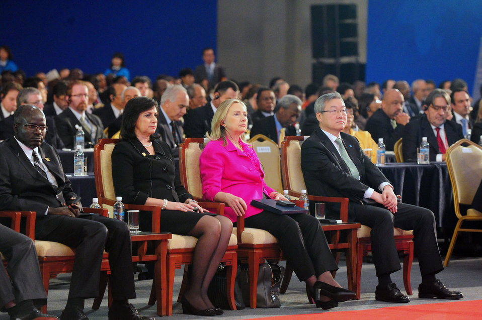 Secretary Clinton Listens to a Speaker