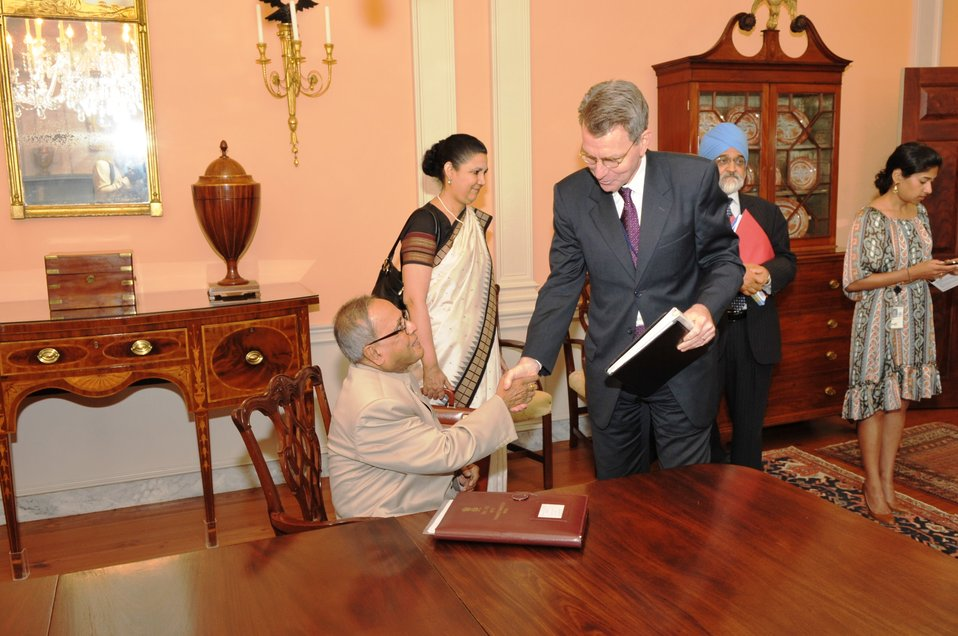 Acting Assistant Secretary Pyatt Shakes Hands With Indian Finance Minister Mukherjee