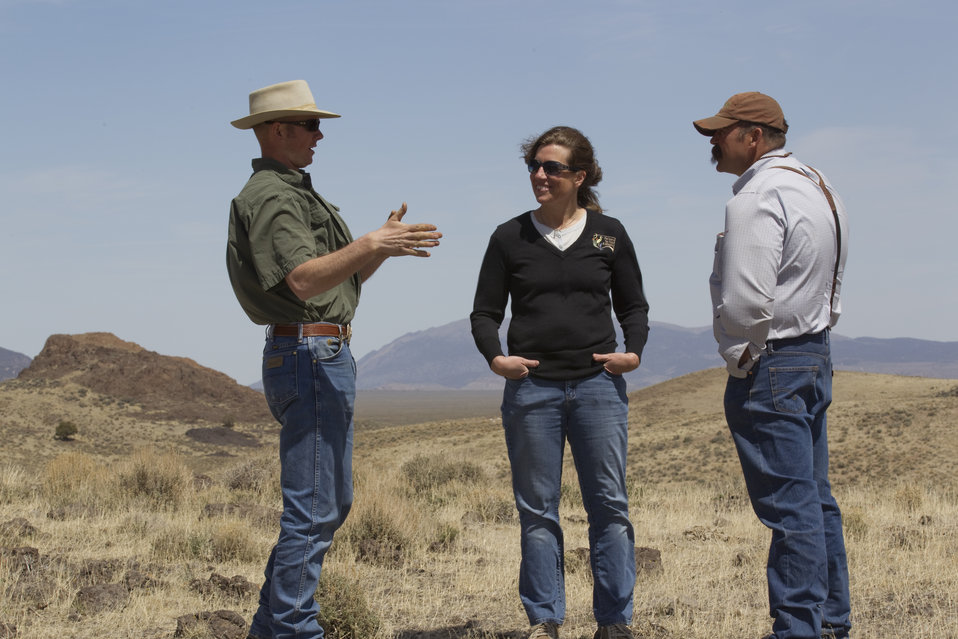 Partners for Fish and Wildlife Biologists with Landowner