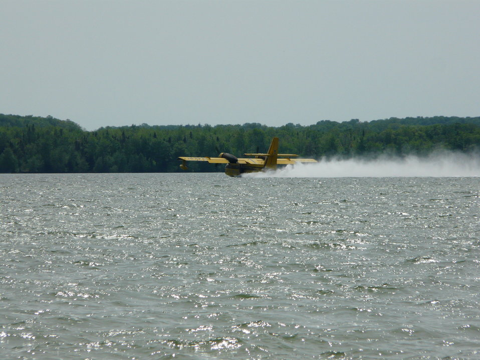 CL-215 Picking up water from Big Manistique Lake