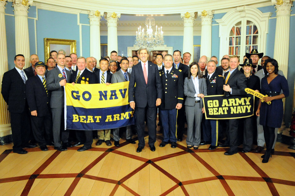 Secretary Kerry Poses for a Photo With Veterans and Military Members