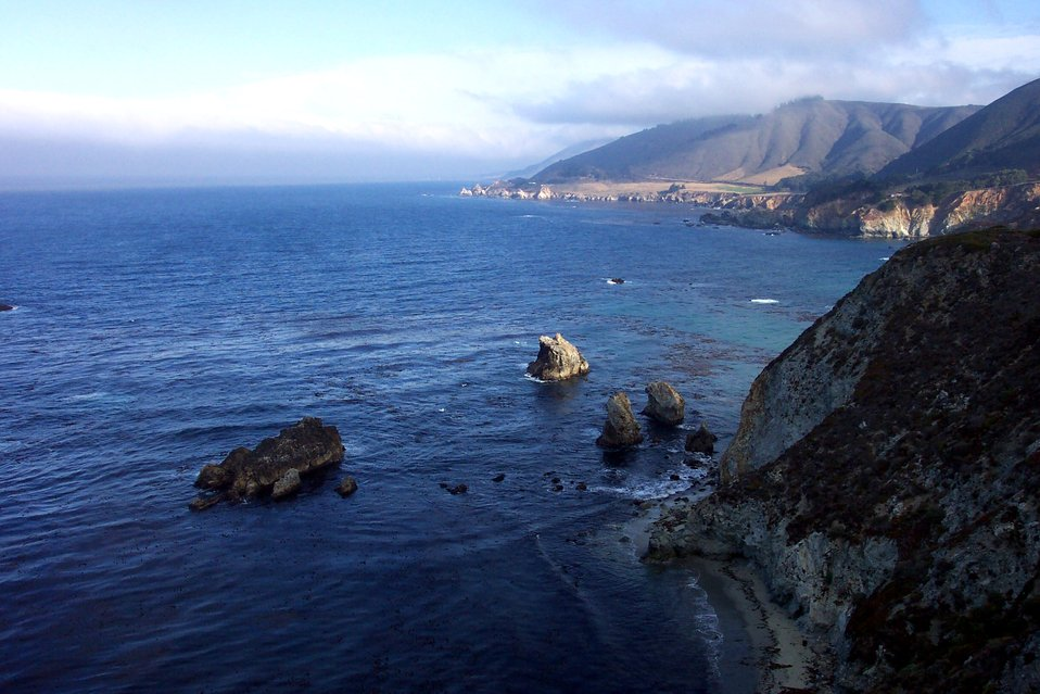 Looking north along the Big Sur coastline early in the morning.  Northwestern slopes still are shaded.