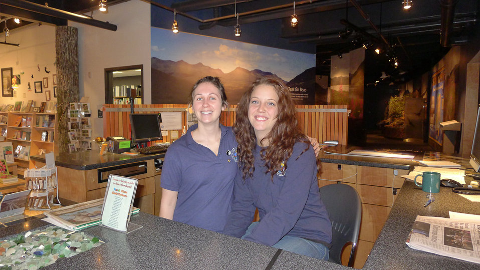Volunteers at the information desk of Kodiak Refuge Visitor Center