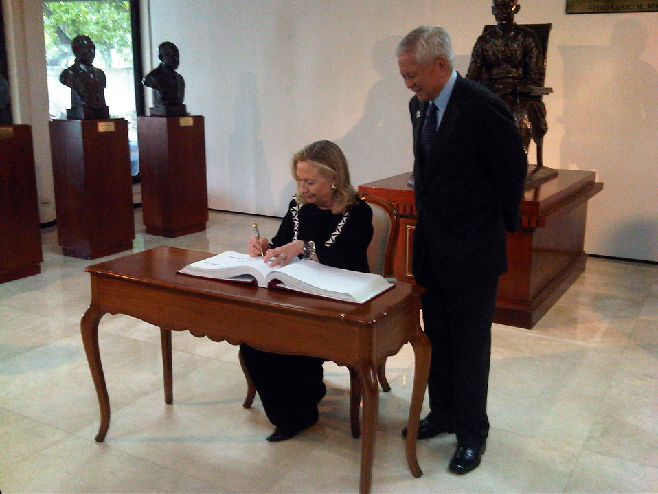 Secretary Clinton Signs Guestbook at Philippines Department of Foreign Affairs