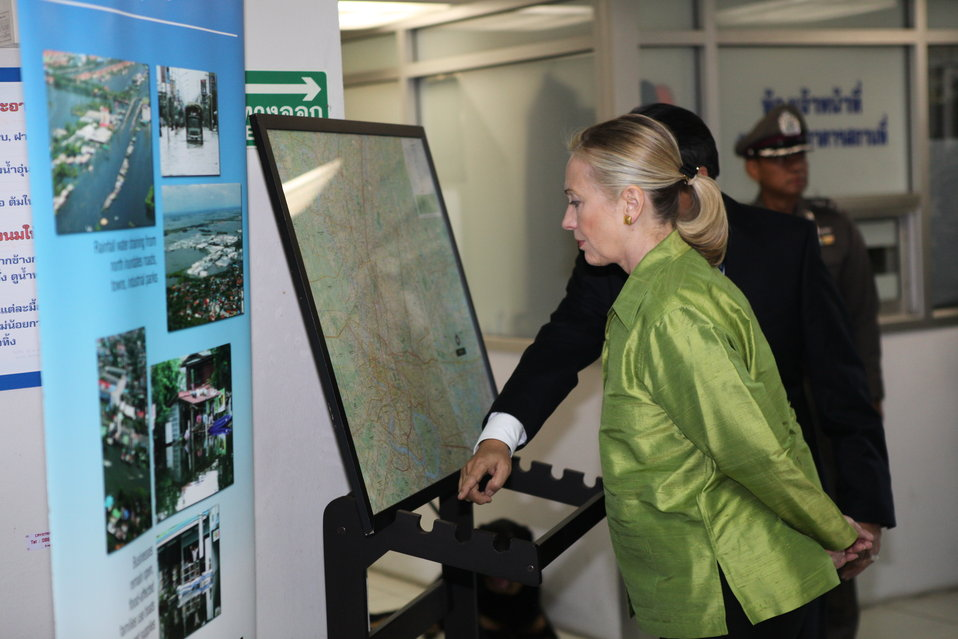 Secretary Clinton Looks at a Presentation of Flood Damage