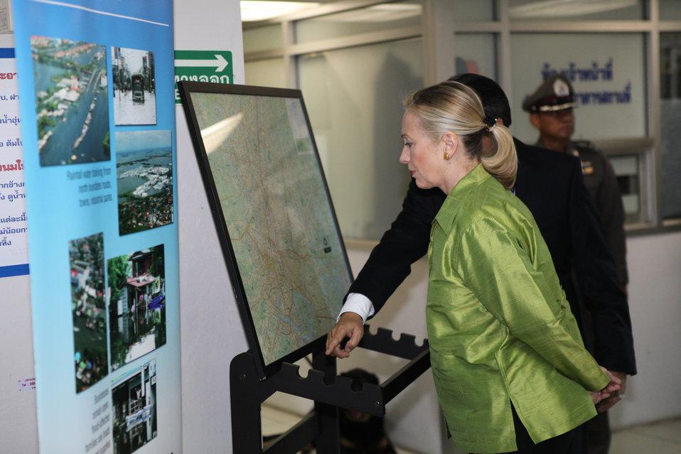 Secretary Clinton Looks at a Presentation of Flood Damage