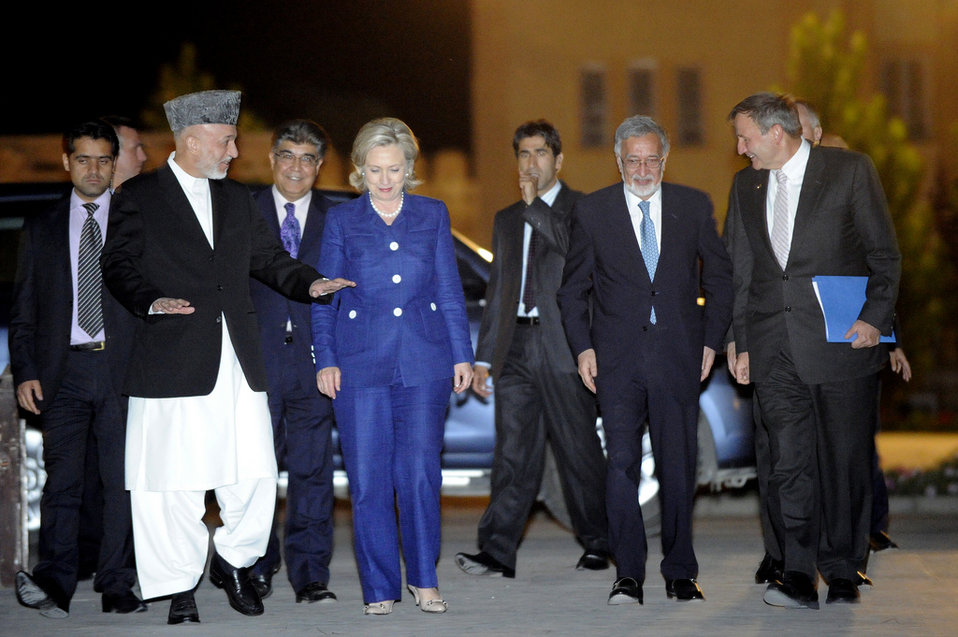 Secretary Clinton Is Greeted By Afghan President Karzai