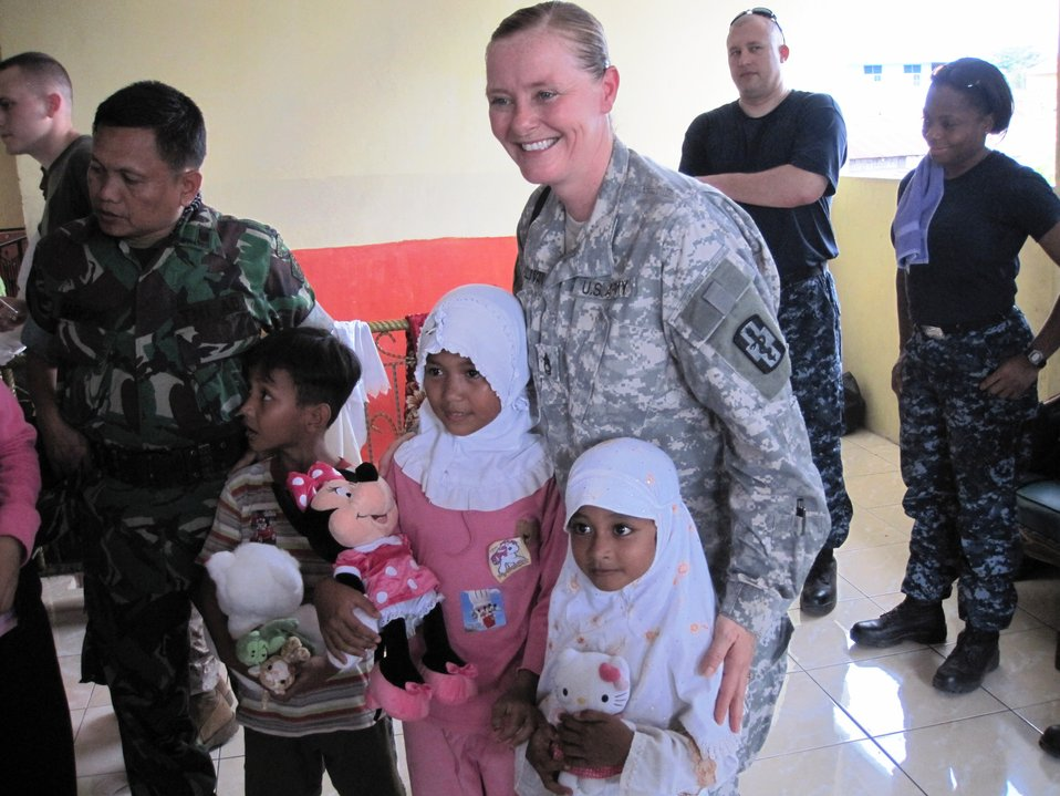 U.S. and Indonesian Personnel Interact With Indonesian Orphans