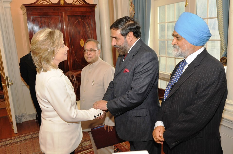 Secretary Clinton Shakes Hands With Indian Commerce Minister Anand Sharma