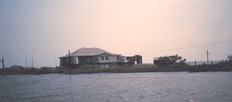 Hunting and fishing camp built on stilts - accessible only by boat although power lines have been run across the marsh.