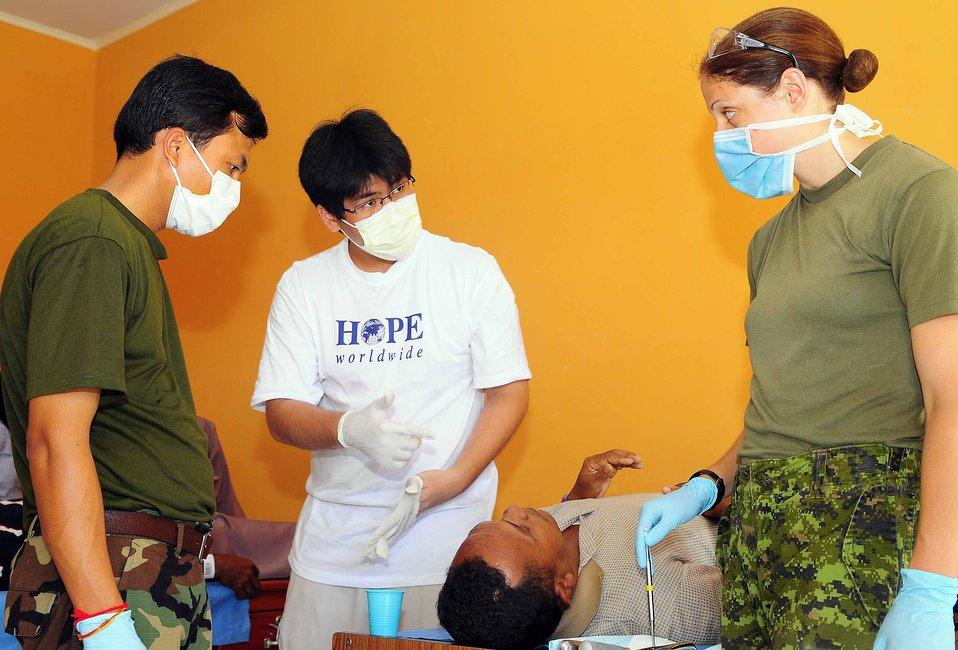 PP 2010 Medical Professionals Treat a Patient