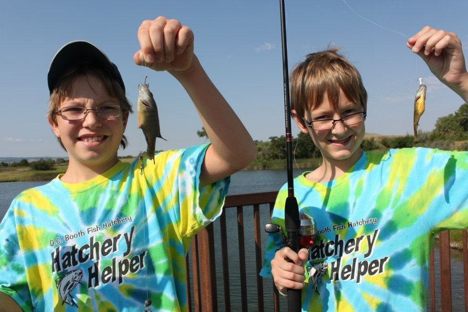 Two proud Hatchery Helpers show off their catch on fishing day!