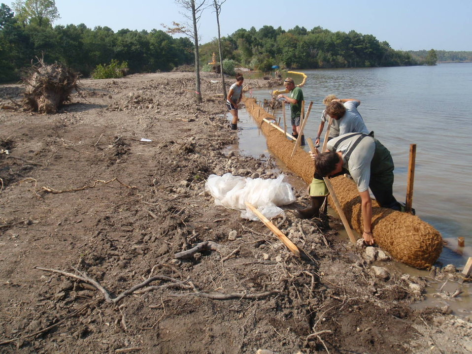 AmeriCorp volunteers assisting with Lake Tecumseh project