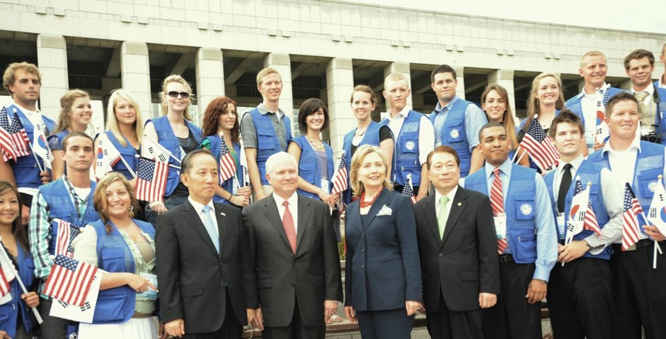 Republic of Korea Defense Minister Kim Tae-Young, Secretary Gates, Secretary Clinton, and Republic of Korea Foreign Minister Yu Myung-hwan Pose for a Photo With Children of Korean War Veterans