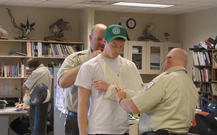 Demonstrating First Aid to Youth Conservation Corps
