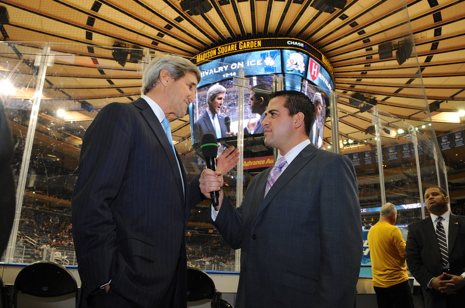 Secretary Kerry Conducts Interview Before Dropping Puck at Harvard-Yale Hockey Game