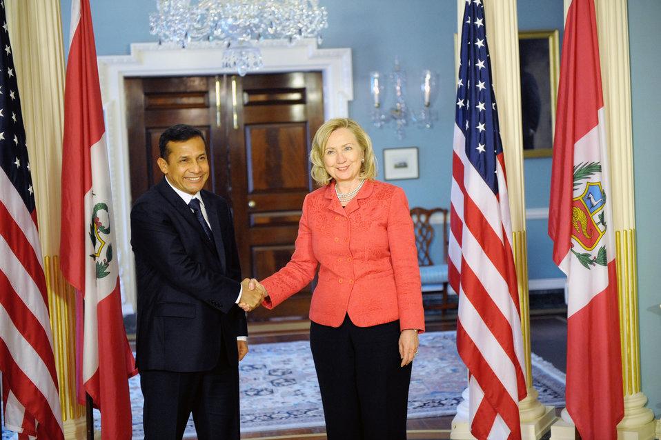 Secretary Clinton Shakes Hands With Peruvian President-Elect Humala
