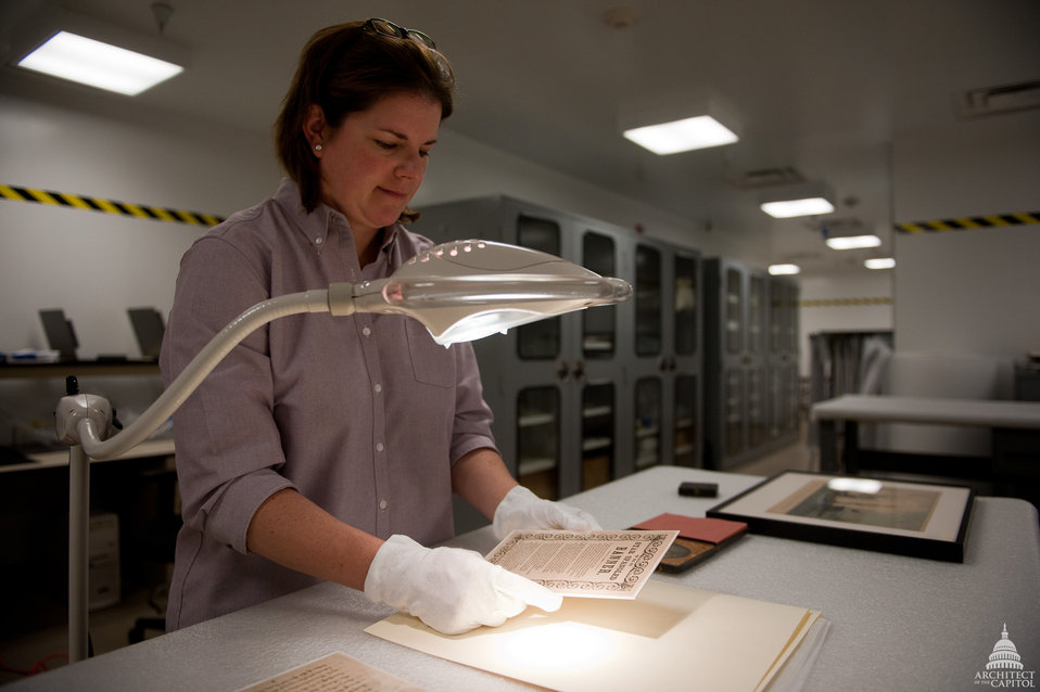 AOC Registrar Examines Artifacts