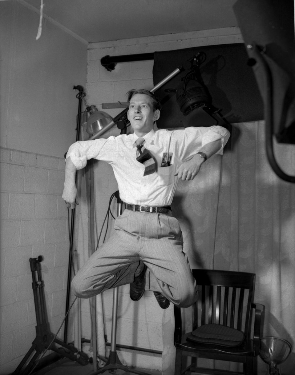 Ed Westcott leaping while testing a strobe in his AEC studio