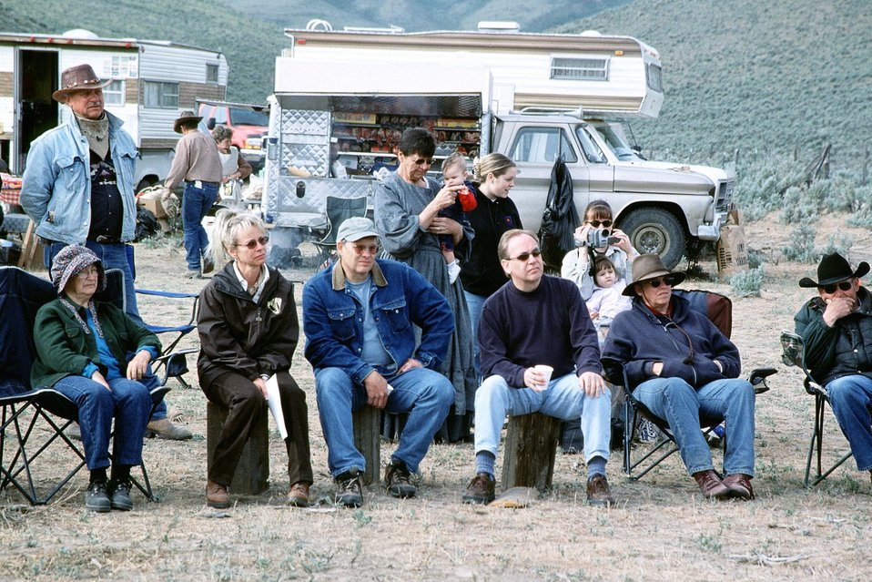 NHOTIC 10th Anniversary, wagon train reenactment. Group shot at encampment (Gay Ernst, NHOTIC Director, seated 2nd from left).
