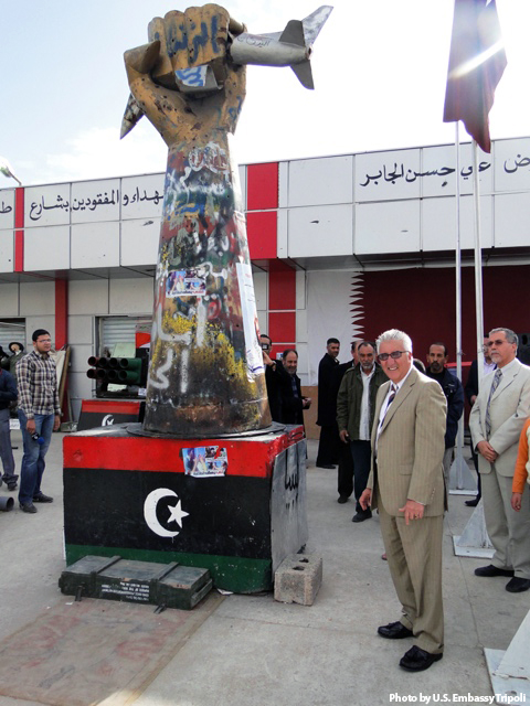 Ambassador Cretz Stands by the Statue That Represents the City's Central Role in the February 17 Revolution