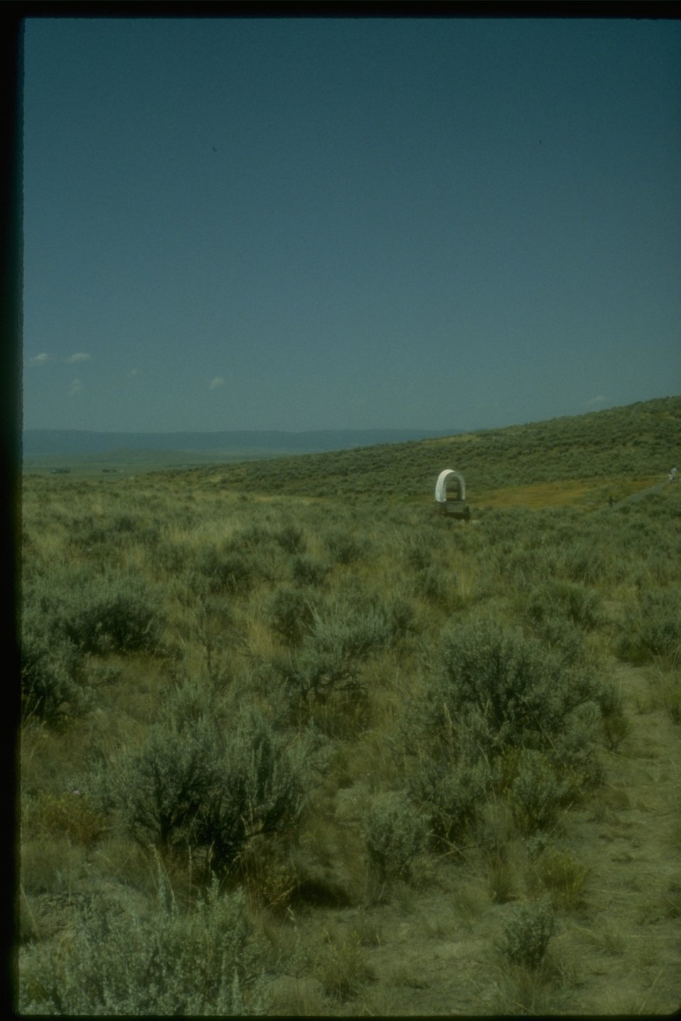 A covered wagon on the historic Oregon Trail near the NHOTIC.