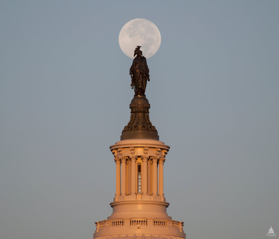 Harvest moon setting behind Statue of Freedom. September 2013