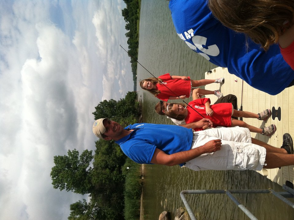 Career Discovery Intern, Tyler Barriere, helps kids fish at Montezuma NWR