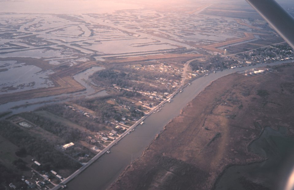 Bayou Lafourche was the main channel of the Mississippi River a few thousand years ago.  As river bed fills, the river changes course seeking a steeper slope to the sea.  If allowed to follow its natural cycle, the Mississippi River would be in the proce