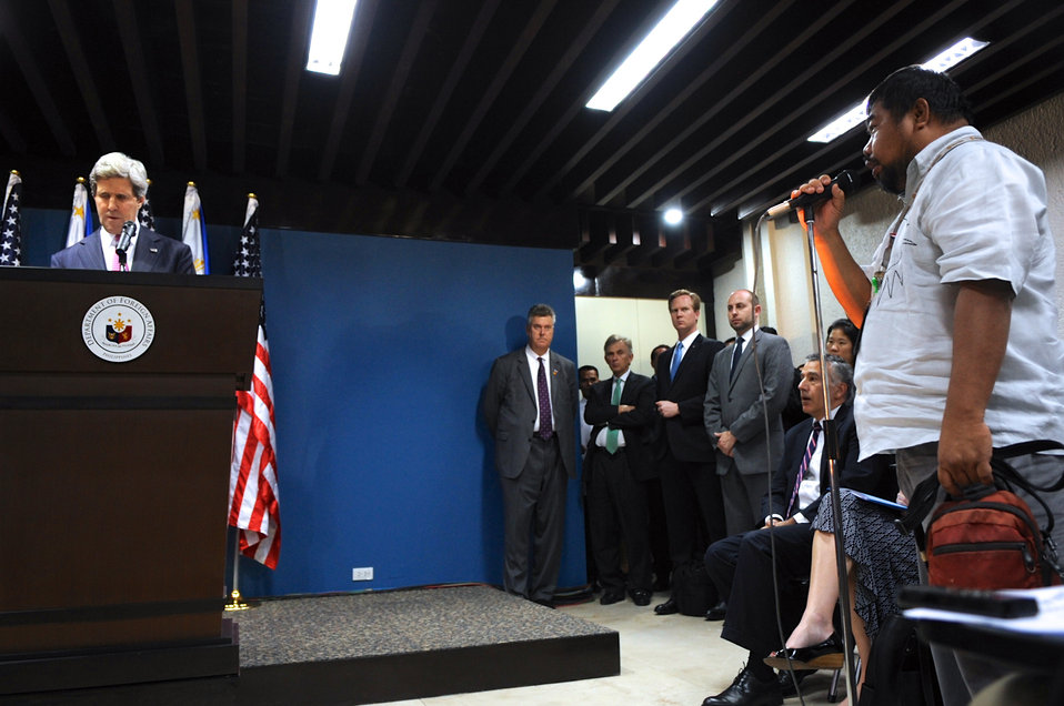 Secretary Kerry Takes Notes on a Question During a News Conference